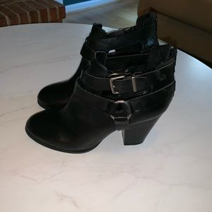 Black ankle booties with buckles